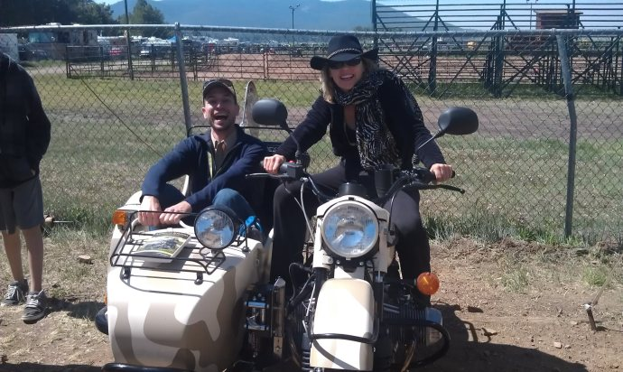 Ben Slavin and Carla King at Overland Expo in a Ural Side Car